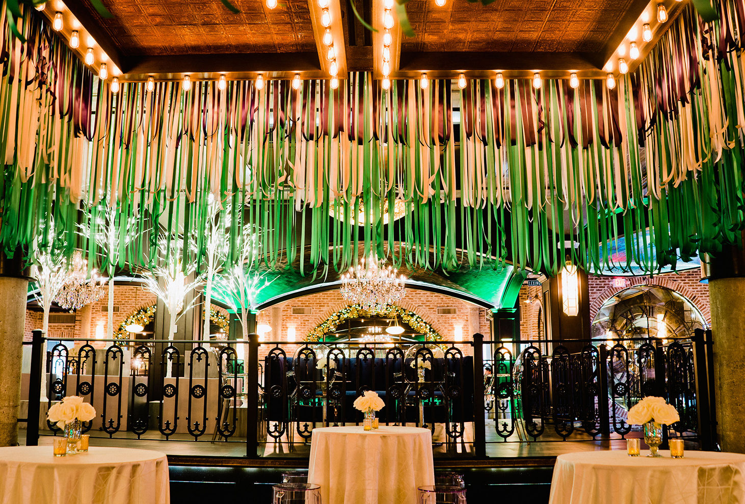 Corporate event with green hanging decor